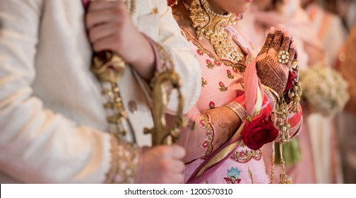 Indian newlyed couple praying wedding day