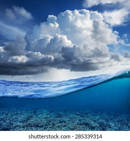 Indian ocean half water shoot with cloudy sky and underwater world discovered