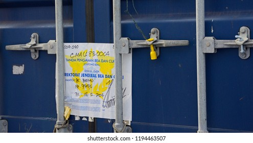 indian ocean, international waters - december 29, 2014: an indonesian  customs seal at the doors of a container stowed on deck of the container vessel cma cgm vela  (imo no  9354923)