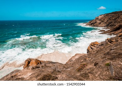 The Indian Ocean and waves breaking on the shore near Cape Agulhas, the southernmost point in Africa. Garden Route, Souther Africa