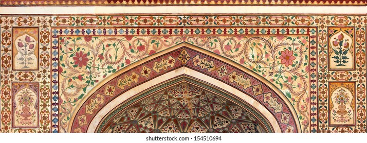 indian ornament on wall of palace in Jaipur fort India