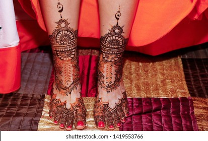 Indian pakistani bridal showing wedding henna art for feet