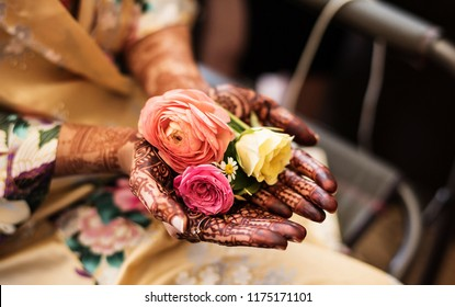 Indian Pakistani Bride Showing her mehndi  and some beautiful roses