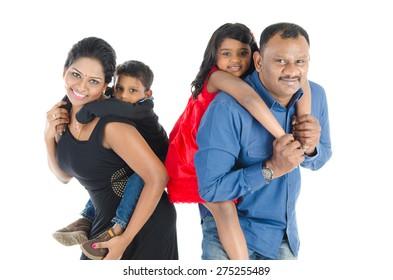 Indian parent piggyback their children
