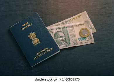 Indian passport with indian currency