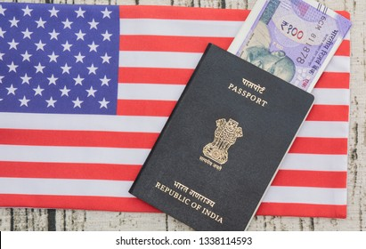 Indian passport with currency on USA or america's flag as a background