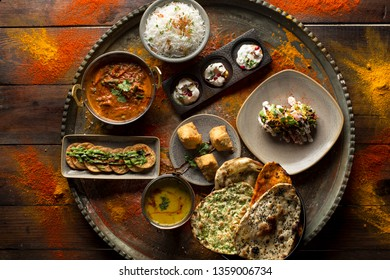 Indian Platter with spices rustic wood background