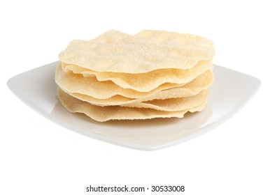 Indian poppadoms isolated on white