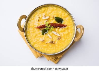 Indian popular food Dal fry or traditional Dal Tadka Curry served in a bowl, isolated over white background, selective focus