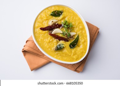 Indian popular food Dal fry or traditional Dal Tadka Curry served in a bowl, isolated over white or colourful background, selective focus