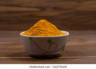 indian powder isolated on wooden background