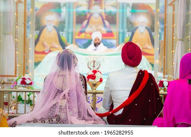 Indian Punjabi Sikh wedding ceremony bride and groom from the back