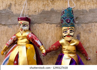 Indian puppets handmade with wood selling in the market as souvenirs