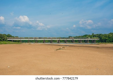 Indian railway's goods train passing through Bharathapuzha river bridge