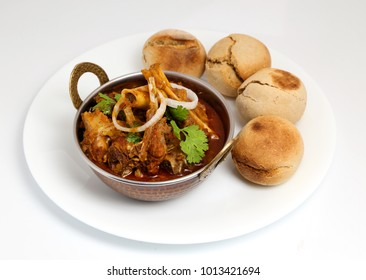 Indian or Rajasthani non veg food. Indian style meat dish or mutton curry with bati.