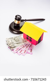 Indian real Estate Law concept showing wooden Gavel, 3D House model and wooden Gavel, Selective focus
