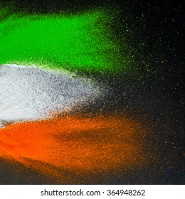 Indian Republic Day celebration background. Red, green and saffron color powders splashed over dark background.