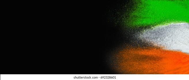 Indian Republic Day celebration background banner. Red, green and saffron color powders splashed over dark background.