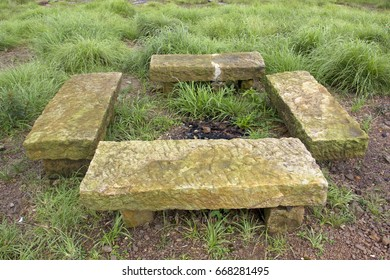 Indian rock bench. Natural siting place. Rock plate.