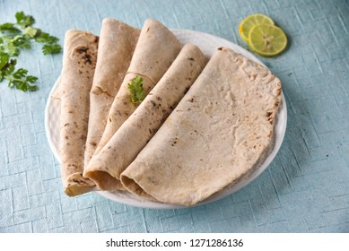 Indian Roti (also known as chapati) is a round flatbread native to the Indian subcontinent made from stoneground wholemeal flour, traditionally known as atta, and water that is combined into a dough.