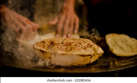 Indian Roti or bread being baked on a pan