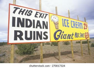 Indian Ruins billboard next to Ice Cream and Milkshake advertisement in NM
