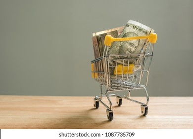 Indian rupee banknotes in trolley on a table, online shopping concept.