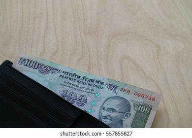 Indian rupee cash in wallet on wood background, finance concept