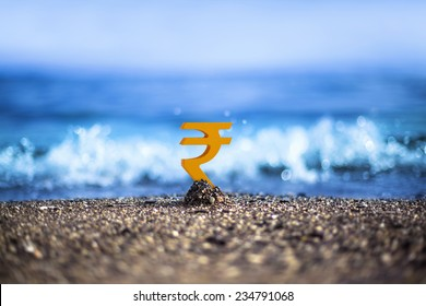 Indian Rupee currency icon is standing on the wavy sea side