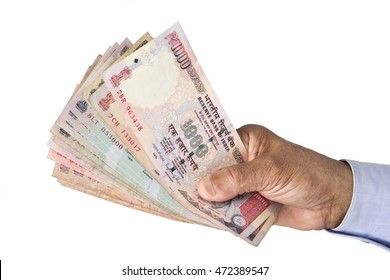 Indian rupee notes in hand in white background