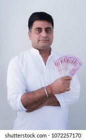 indian rural farmer showing money