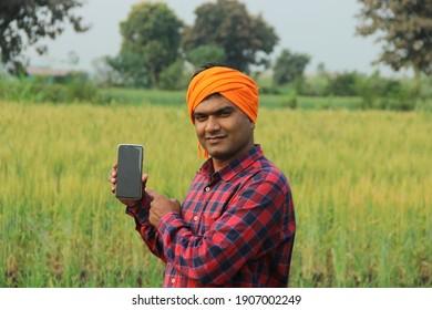 Indian Rural Farmer Young Man Using Mobile Phone Standing Farm Akole, Maharashtra, India - February 02 2020