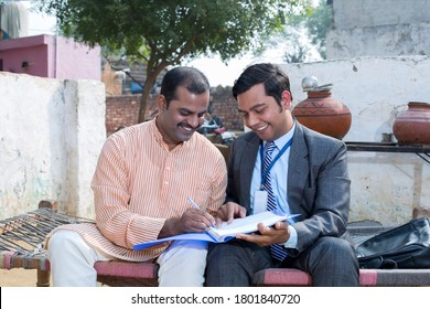indian rural men meeting with financial advisor at village