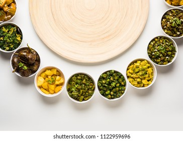 Indian sabzi / vegetable fried recipes served in white bowl over moody or colourful background. selective focus