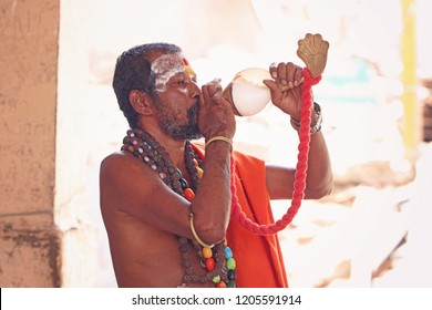 Indian Sadhu blowing the conch