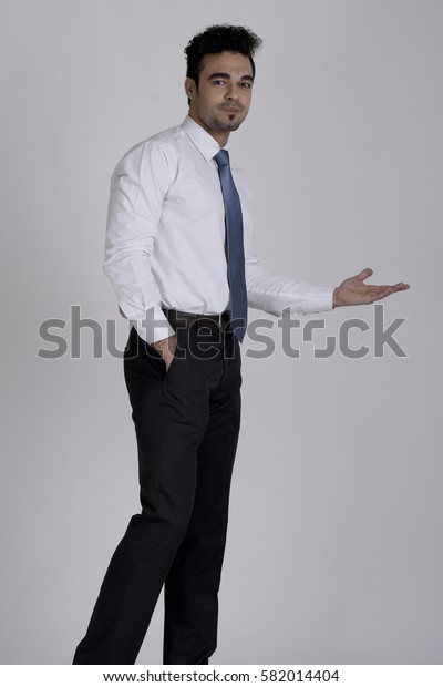 Indian salesman with an open hand gesture and side profile