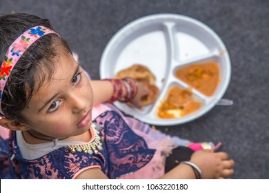 Indian school children eat their free midday meal at a government school in Haryana