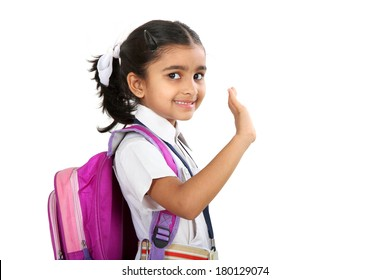 Indian school girl  saying good bye and waving to her hand.Isolated on white background.