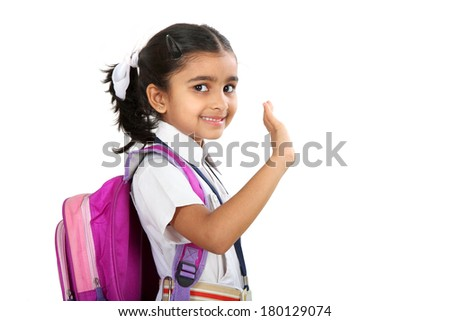 Indian School Girl Saying Good Bye And Waving To Her Hand Isolated On White Background