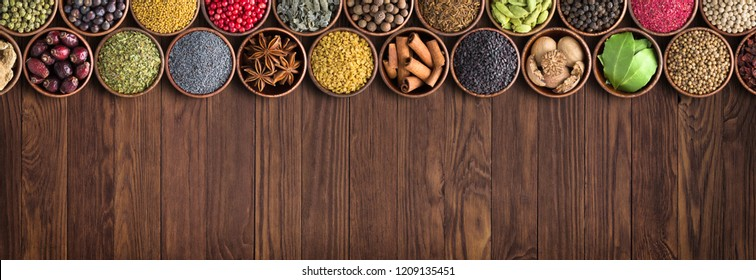 Indian seasonings and herbs, top view. condiments on table background