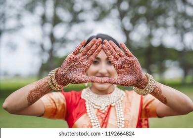 Indian showing Bridal mehndi design and Making Love heart shape on Hands Karachi, Pakistan, September, 01, 2018