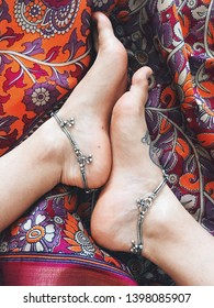 Indian silver jewerly. Ankle bangles. Anklets. Girl's feet with payals