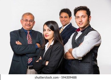 Indian smart Business people OR lawyer in suit standing as a team, isolated over white background, looking at camera