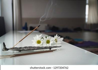 indian smoky aroma sticks with flowers;