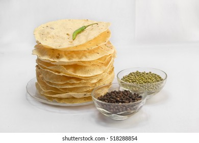 Indian snack deep fried papad / crackers. Mung dal and urad dal papad an Indian fried dish, which is an side dish for lunch and dinner.