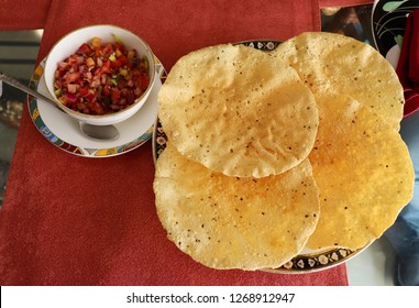 Indian snack, Fried Papad or papadam with spicy onion and tomato salad called Masala Papad