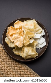 Indian Snack Papad, deep fried and roasted, made up of Urad, Moong dal or rice. Selected focus