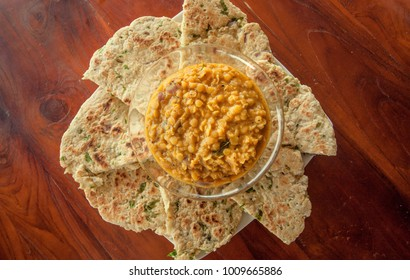 Indian snack, roti bread and vegetarian dal made from lentils or beans. Also food popular in Nepalese, Pakistani, Sri Lankan and Bangladeshi cuisines.