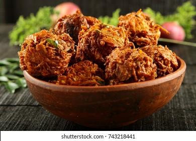 Indian  snack spicy onion fritters.pakora ,pakoda.