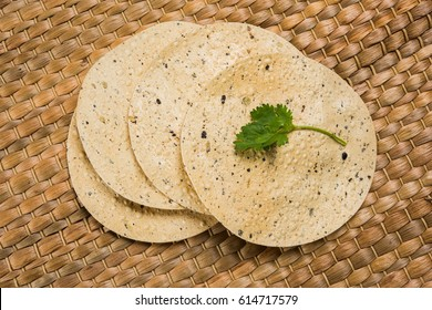 Indian snacks, deep fried or roasted crackers or papad. Mung dal and urad dal papad an Indian fried dish, which is an side dish for lunch and dinner.